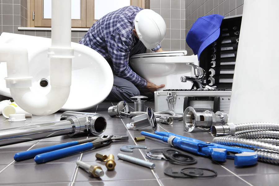 Plumber At Work In A Bathroom, Plumbing Repair Service, Assemble