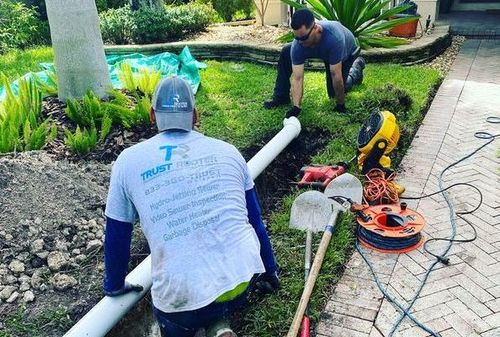 plumbers replacing sewer drain