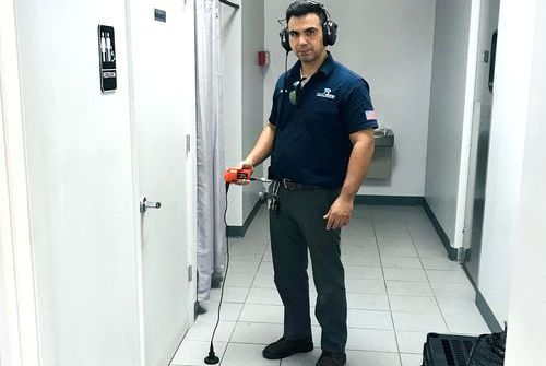 plumber using a water leak detector equipment
